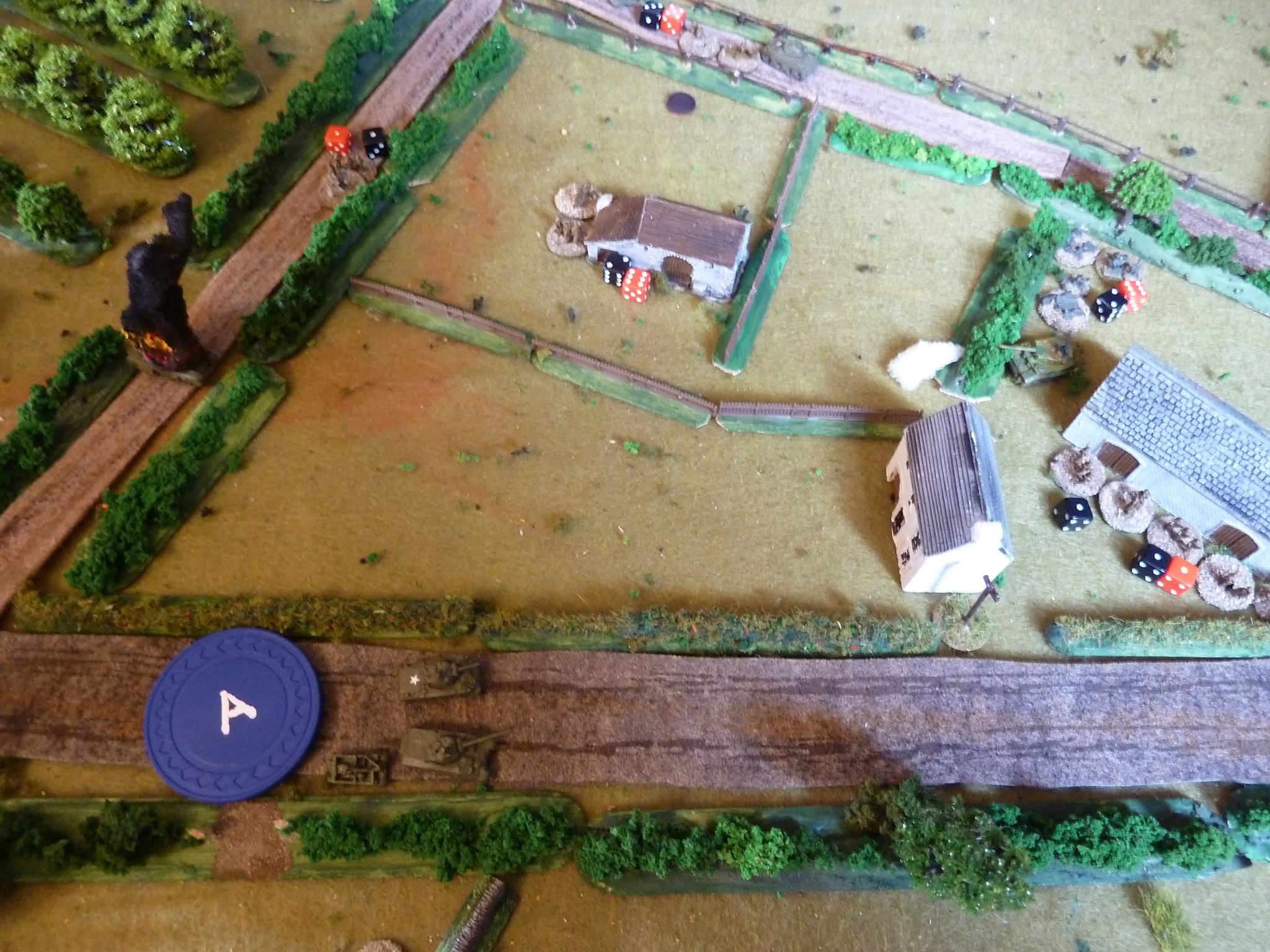 The sections from No 3 platoon ignore the Tiger close by and dash across the stables, chasing the fleeing German squad.