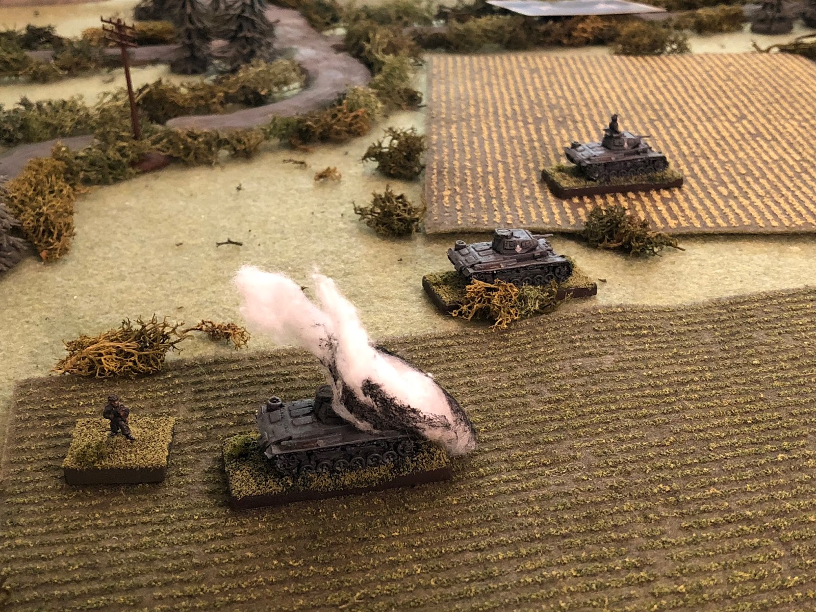 BAM!!!!  SSgt Grossman, groggy from shock and bleeding from his forehead and his loader are the only crew members able to bail out of the disabled Panzer III.