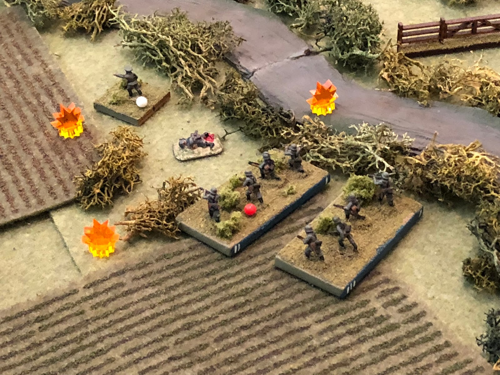 And the French fusillade is furious, knocking out SSgt Aust's 1st Squad and suppressing Lt Klugmann and Sgt Kamphaus' 2nd Squad (red bead, Lt Klugmann has a white bead but it should be red, too, I just screwed up).