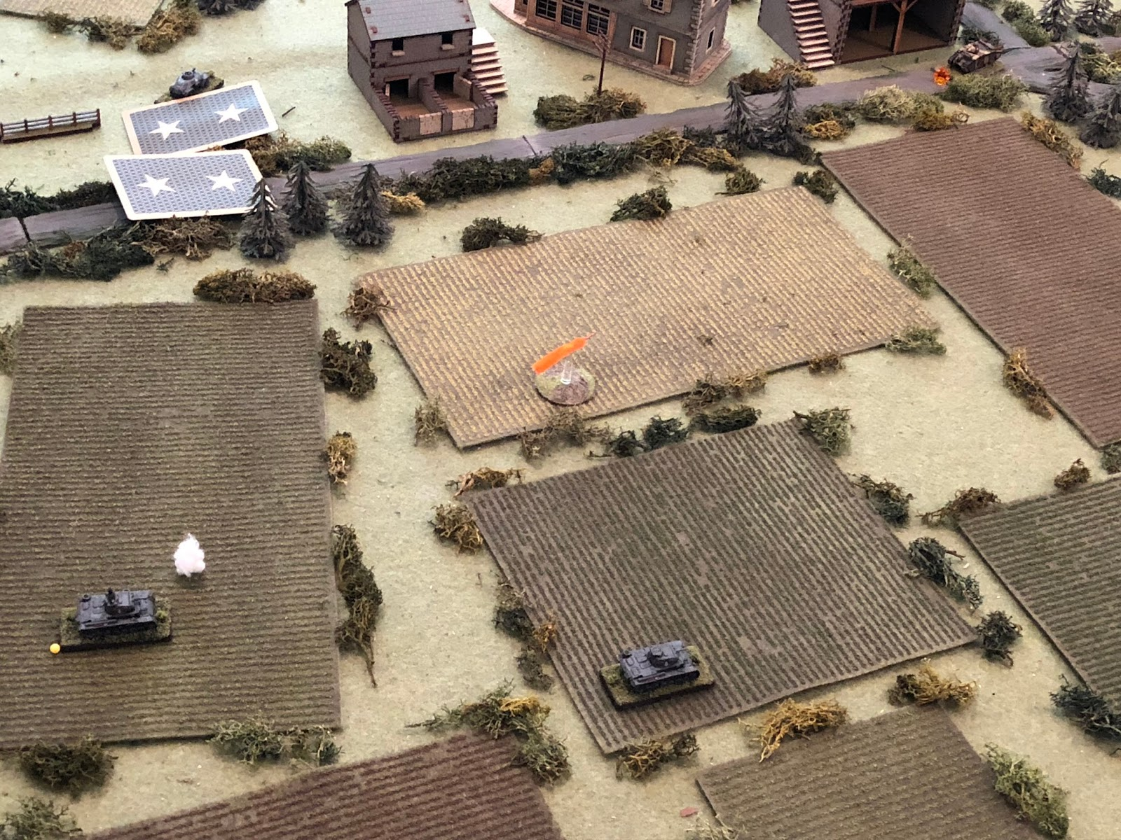 While Sgt Mayer pushes his tank west at speed (bottom centre), looking to get on the enemy tank's flank.