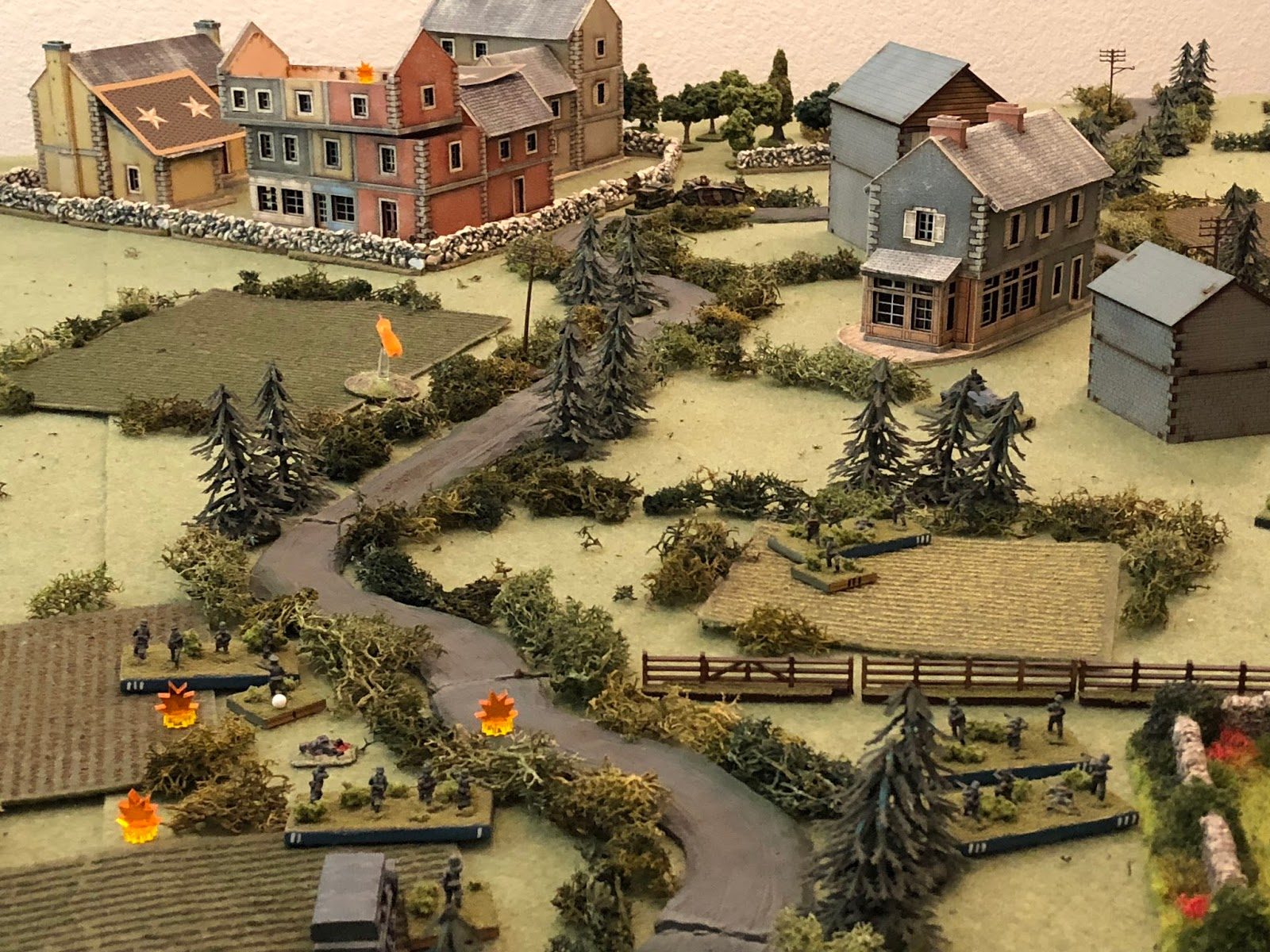 The German infantry slowly manage to get into the fight, with Sgt Lehmkuhl and Sgt Kamphaus' squads (bottom left) opening fire on the ville (top centre left)...