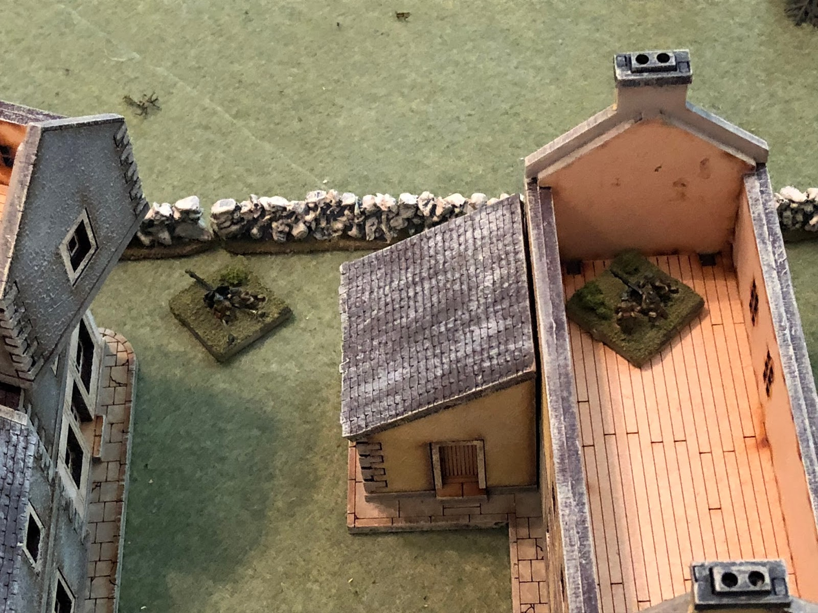 With his 2nd Platoon temporarily hors de combat, Major Renaut commits his Weapons Platoon: the tripod-mounted Hotchkiss on the 2nd floor in the far south (2nd Platoon is in the building at bottom left), and the 25mm anti-tank gun at ground level, below.  *I told the boy he needed to put the ATG in the spot where he expected the most tanks to be, and he understood, but he just wasn't able as neither one of us had any success getting our blinds to move once we got troops on the table.