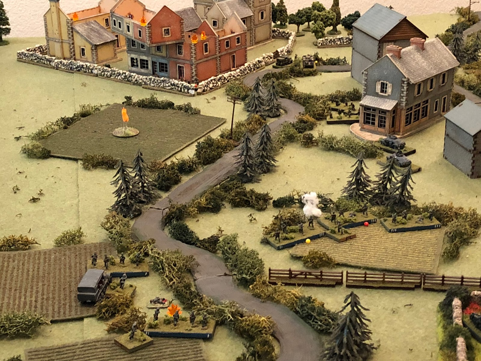 While Sgt Lehmkuh'ls squad (bottom left) fires on the enemy machine gun position (top left, in yellow building).
