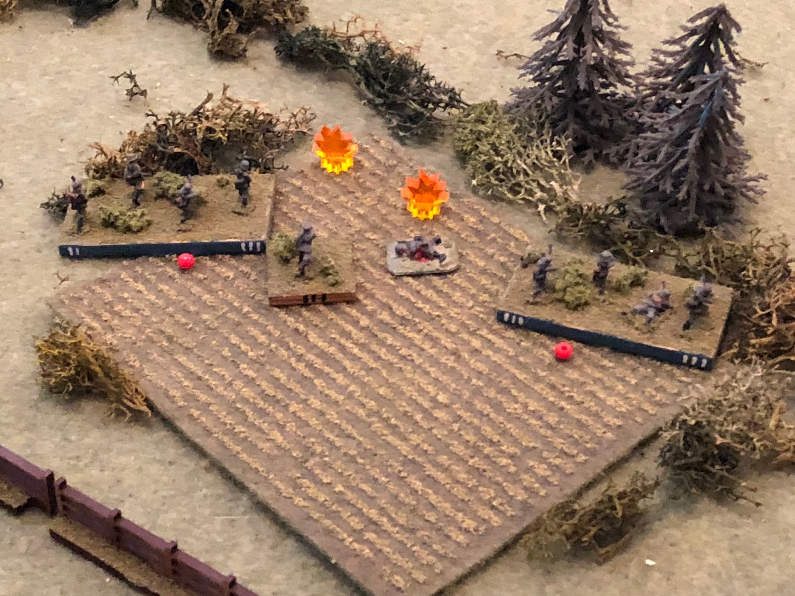 And the fire is vicious!  Sgt Imhofe's squad is eliminated, while Sgt Kandler and Cpl Rishel's squads are both suppressed!  *Ouch!  Good dice, but helped by the fact the French were firing down on the Germans, who were essentially in the open because of the elevated line of fire.