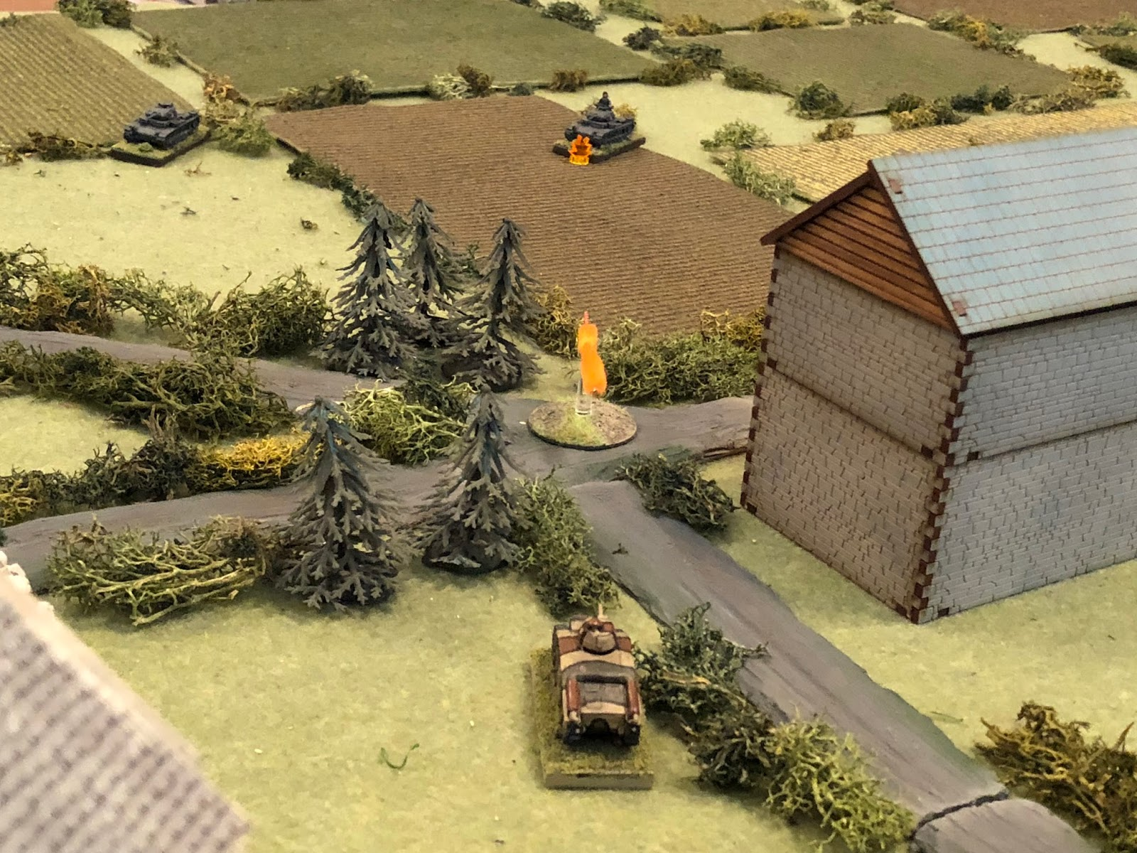 And as they do, Sgt Guillaume pivots his tank left and fires on Lt Loeb's Panzer III (top centre)...