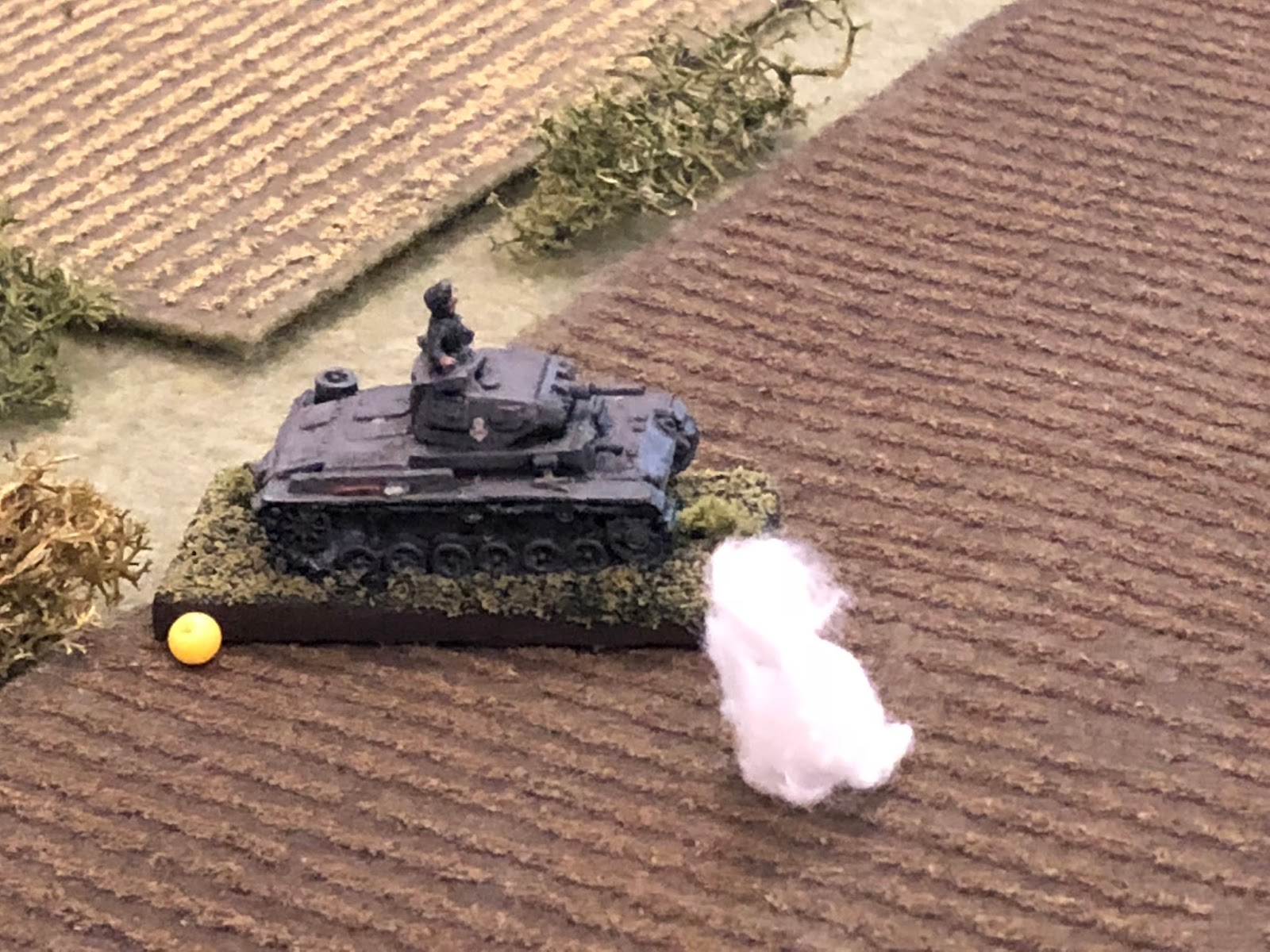 Again the German vehicle is rocked by a near miss, but they continue pushing forward.