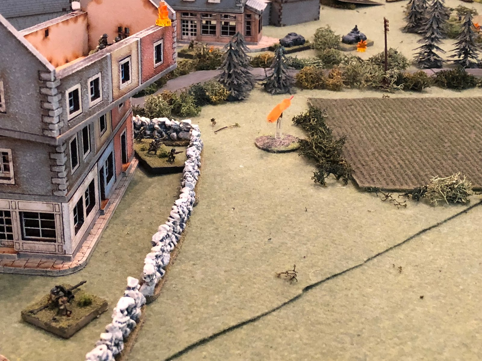 And then the enemy ATG (bottom left, with the French 2nd Platoon in the building at left and at ground level, above them) gets into the fight.  The enemy gun captain cranks the weapon over, lines up on Lt Weidner's armored car (top right), and fires...