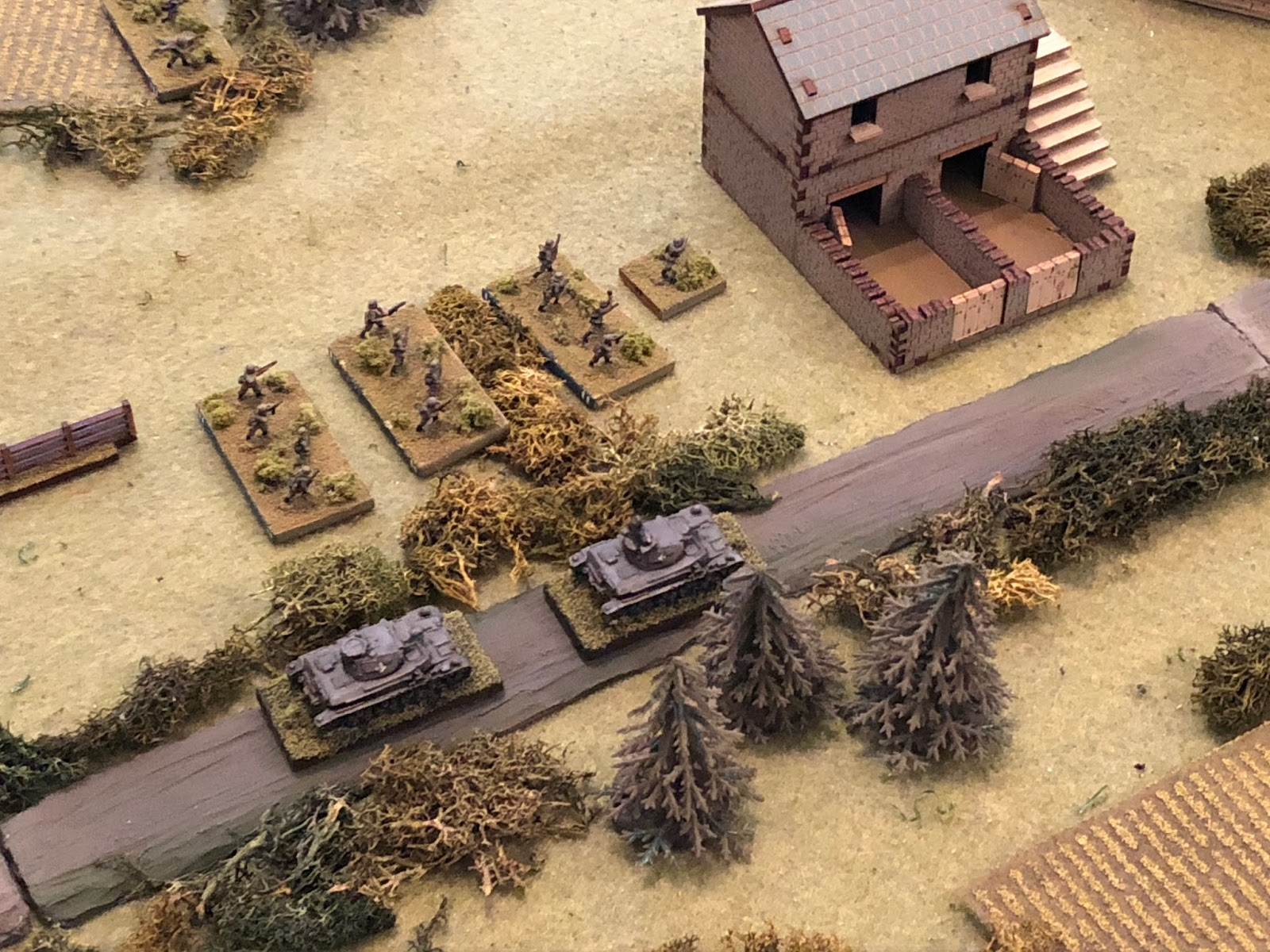 At this point the German commander can't take it anymore and kicks SSgt Janke and SSgt Mangold in their asses, screaming at them to get into the fight!  They quickly stub out their cigarettes and head off to their waiting men and vehicles.  *I belatedly make the decision to pull 3rd Platoon and 2nd Tank Platoon off of Blinds and get their cards into the deck so I might get some use out of them.  Something else is, I never did put the Kampfgruppe Commander on the table!  I was wracked with indecision: do I put him in the south to help the two beat up infantry platoons?  Do I put him in the west with Lt Loeb's two panzers?  Do I put him in the centre to get these two platoons moving on the objective?  I couldn't make up my mind and ultimately got overtaken by events.  Now that's some serious friction and fog of war! ;)