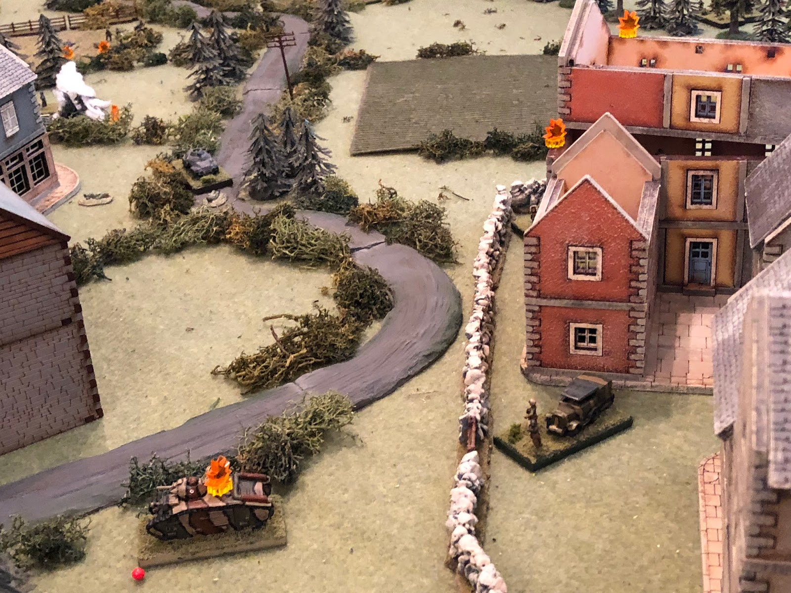Major Renaut (bottom right) looks on as the German infantry are pounded (top left).  2nd Platoon and the machine gun (top right) are holding strong, the anti-tank gun (behind the buildings at right) is being re-posititioned; I just need to get Sgt Guillaume's crew (bottom left) rallied, and we may just hold, he thinks to himself.  *My boy is complaining aloud about his chances of holding the village, but I'm not feeling so confident myself...