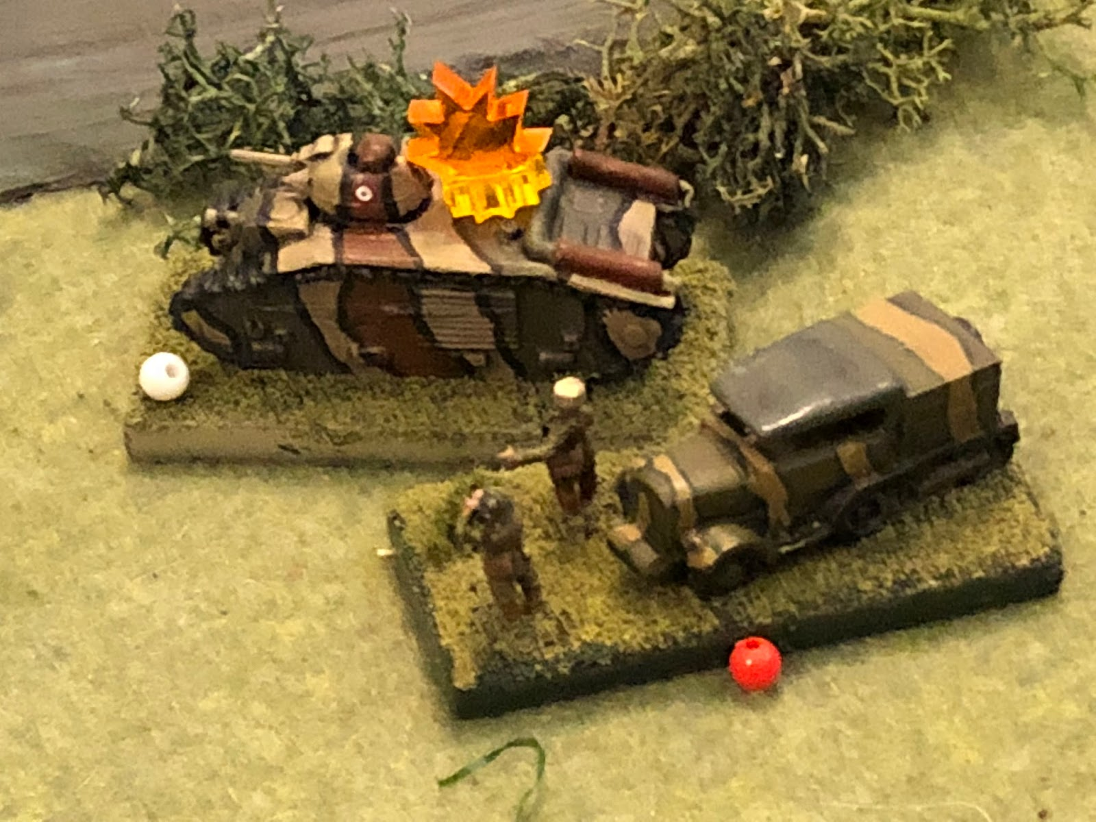 The low velocity 75mm round slams into the enemy tank, the explosion suppressing Major Renaut and his command group.  Sgt Guillaume, inside the stricken tank, searches about, thankful to be alive.  The Char B is immobilized, but the crew has not only stayed in the vehicle, they remain prepared to fight!  *Some incredible dice rolling by the boy saw the crew stay in the immobilized tank AND not become suppressed, each with a 33% chance of occurring (I think he rolled back to back 6s)...