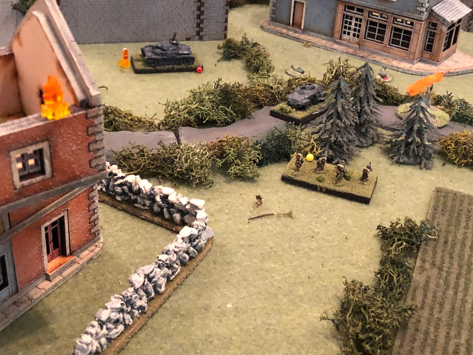 When the French tank round skipped off of SSgt Mangold's Pz IV (top centre) it made a hell of a CLANG!, drawing Cpl Edsts's attention (centre top right, on the road), distracting him long enough for the French 2nd Platoon squad at ground level to hop the wall and dash to a nearby stand of trees (centre right, from centre left).  *The boy knows his troops have a good chance of close assaulting and winning against the Sdkfz 221 armored car, and if they can beat that it will be a cinch to take out SSgt Mangold's shaken up panzer crew.
