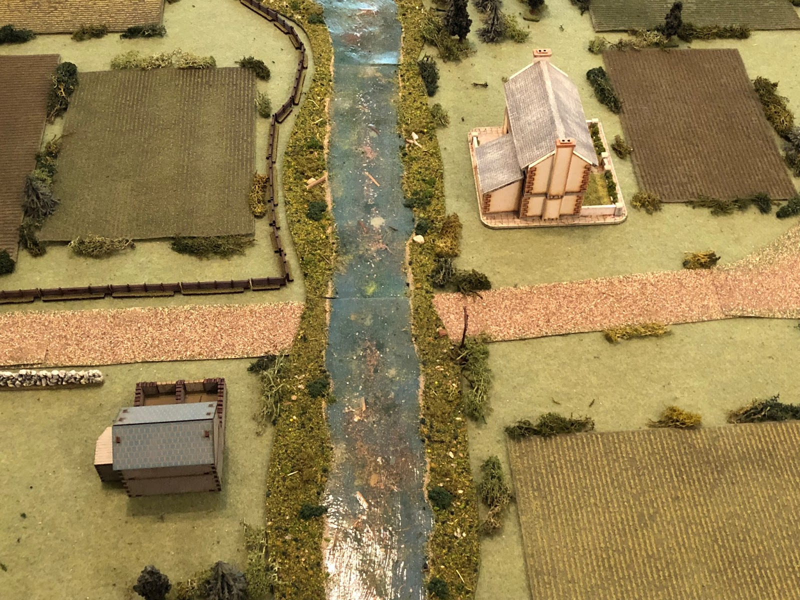 A close up of the objective, the ford (center), with the tollkeeper's home at bottom left and Mlle Chevelle's home at top right.  You get a good look at some of the cabbage fields and the wooden fence running on the north side of the main road.