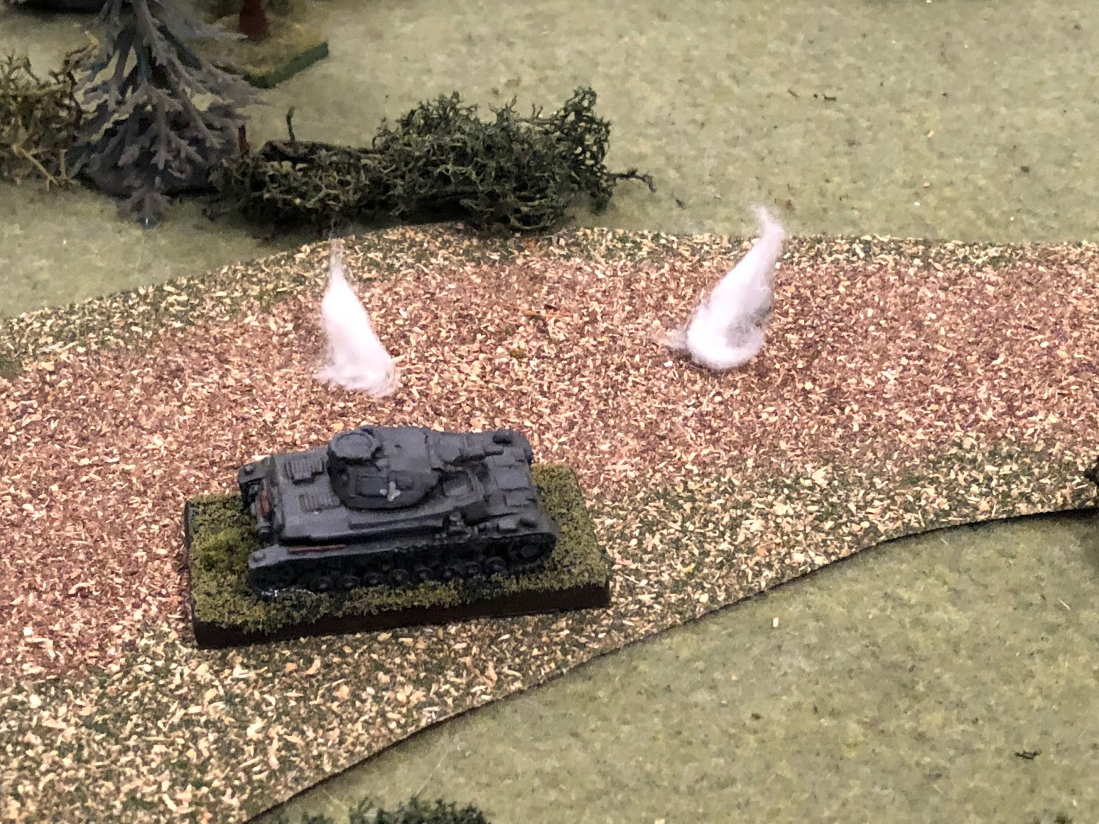 Sgt Kapps' vehicle pushes through the showers of earth and shell fragments, unperturbed!