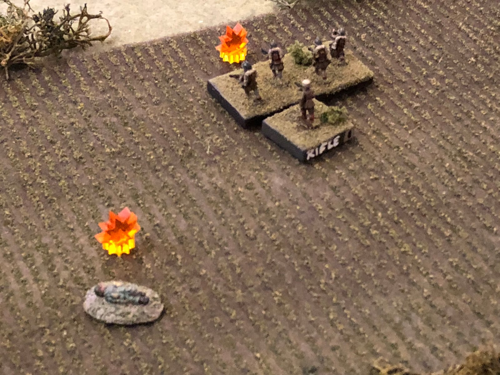 But the fire from the other two Motorcycle Platoon squads is vicious, knocking a French squad out of the fight!  All this shooting, but so far all that's been lost is one German ATG and one French rifle squad.
