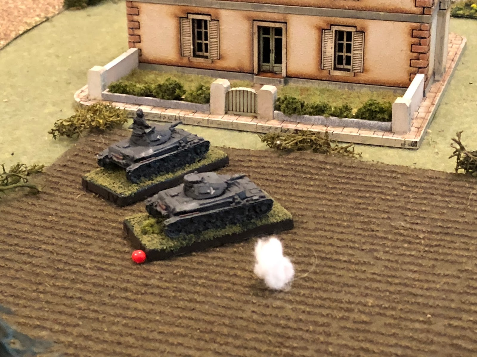 The enemy shell plows the cabbage field at Sgt Kapp's right flank.