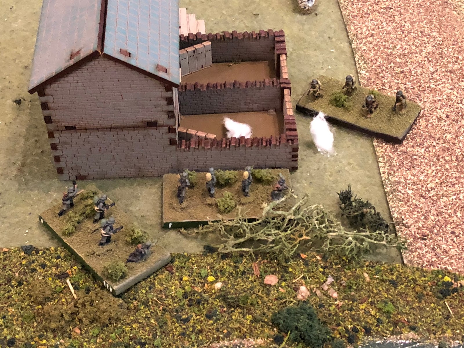 Sgt Barkstrom moves his squad over (bottom left) and rallies Sgt Hafl's squad back into the fight, just as Adrian helmets begin popping up over the wall to their right...