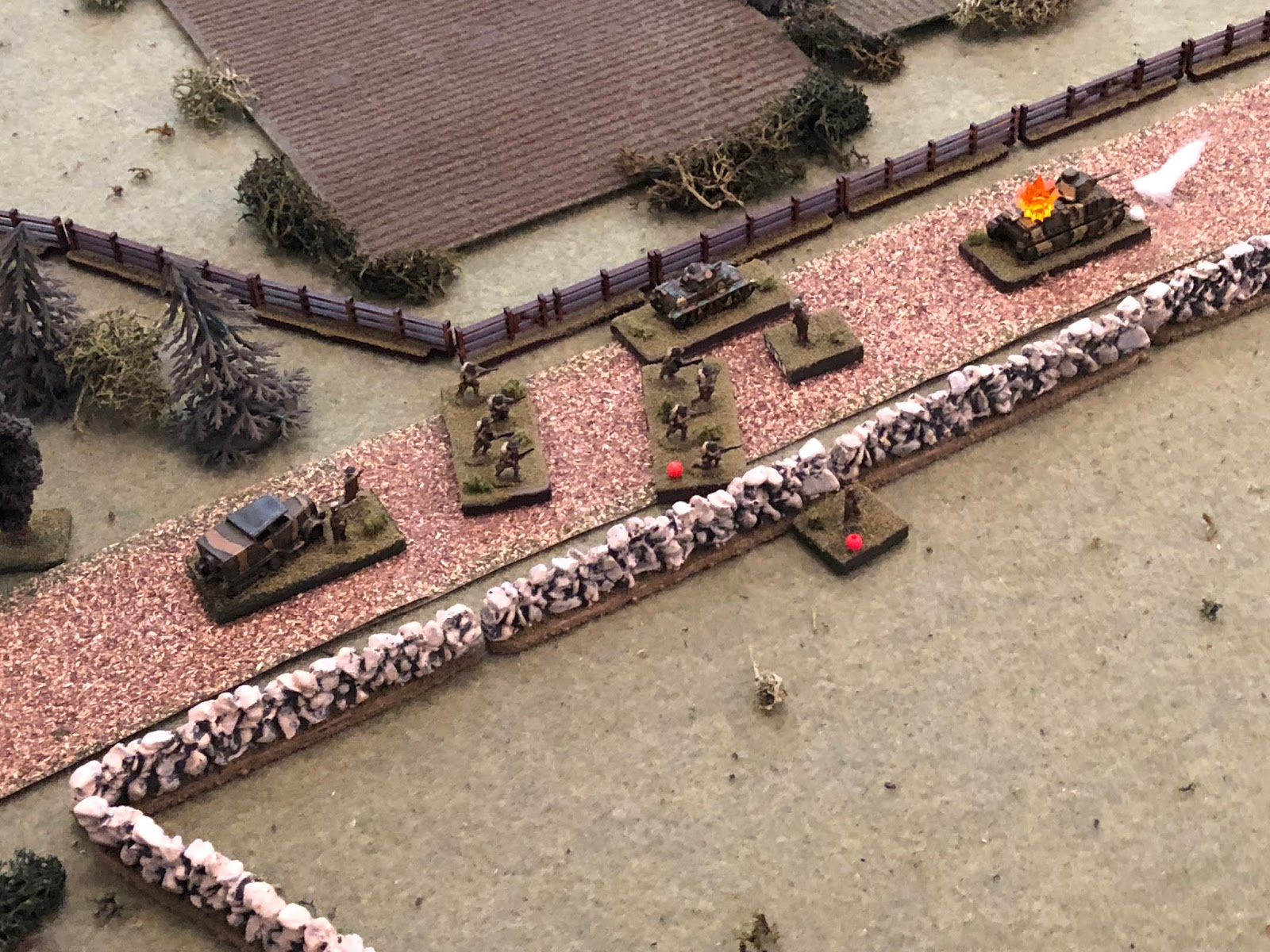 The French H39 light tank begins moving east down main street, skirting left (center) around 2nd Platoon.