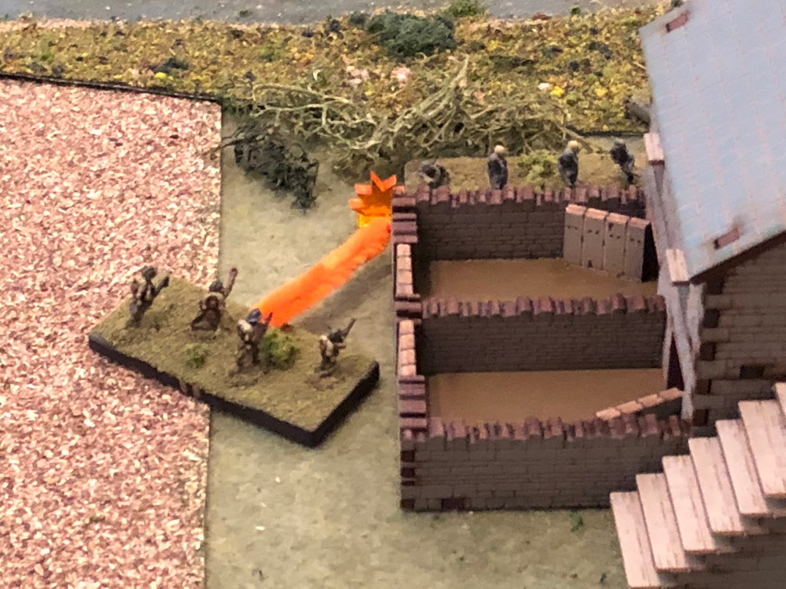 1st Squad pops up and cuts loose with a brutal fusillade at point-blank range on the German engineers...