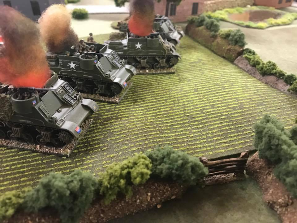 Kangeroo carriers ablaze. The infantry lost half their number.