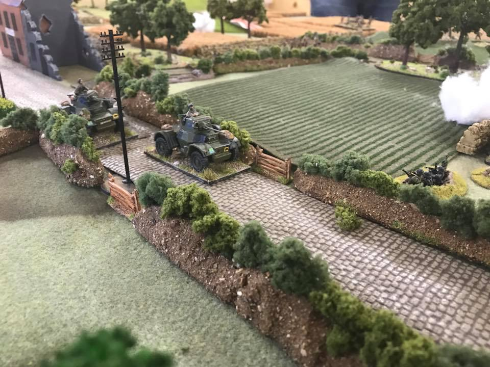 The recce troop roars down the road to outflank the central German force.