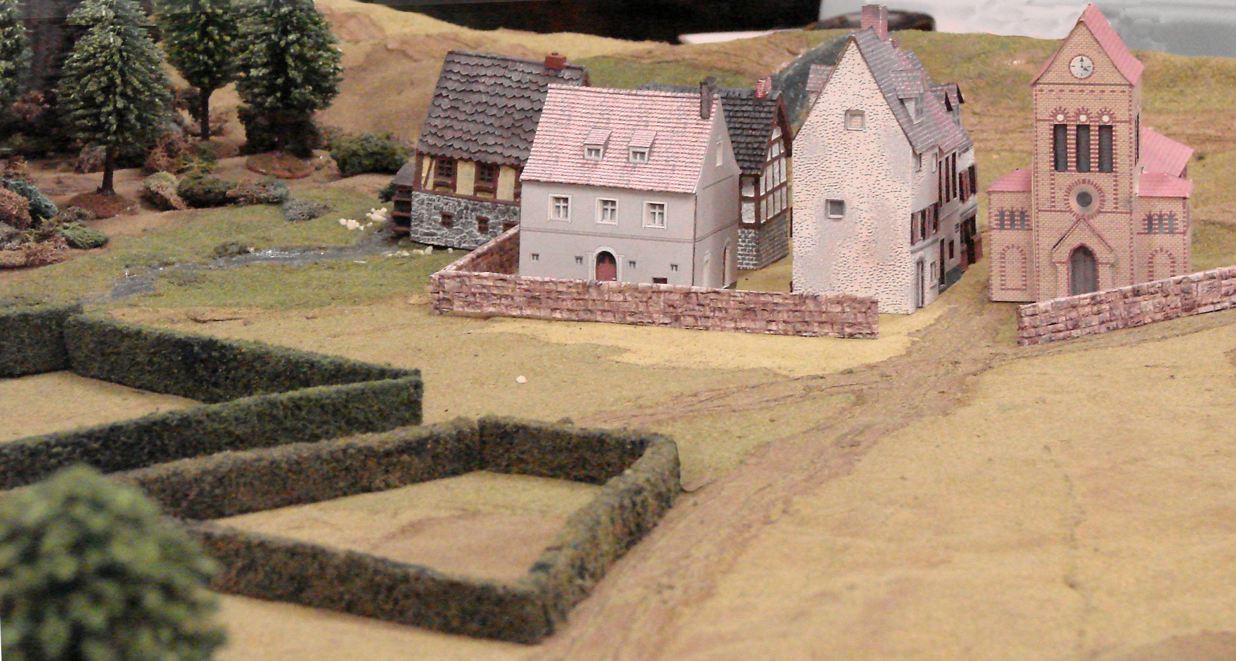 In the rear of the American position, hedged fields provide cover for a fall-back position, and a small village becomes company HQ.