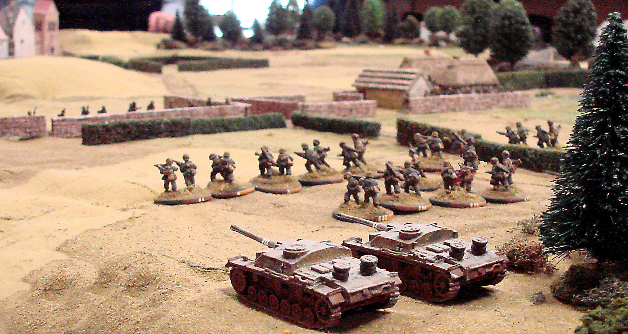 On the left flank, an advancing platoon is supported by a couple SturmGeschutzen.