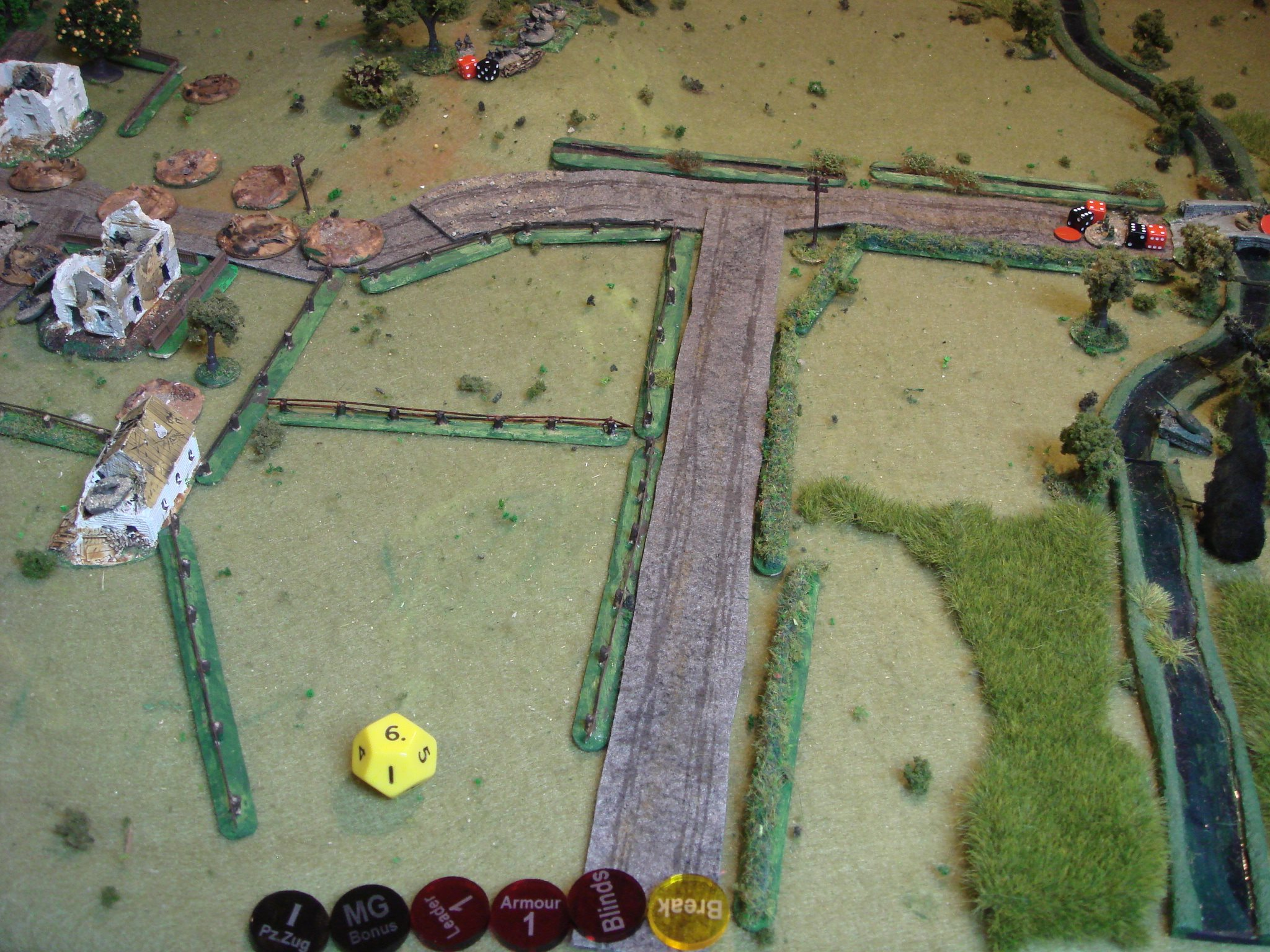The MMG at the top opens fire on the Soviet platoon crossing the bridge. At Close Range it is murder and the lead squads on the bridge are decimated!  The Tiger has started to pick off the T-34s as they appear. Despite taking a few hits, its armour is too much for the /76s and /85s.