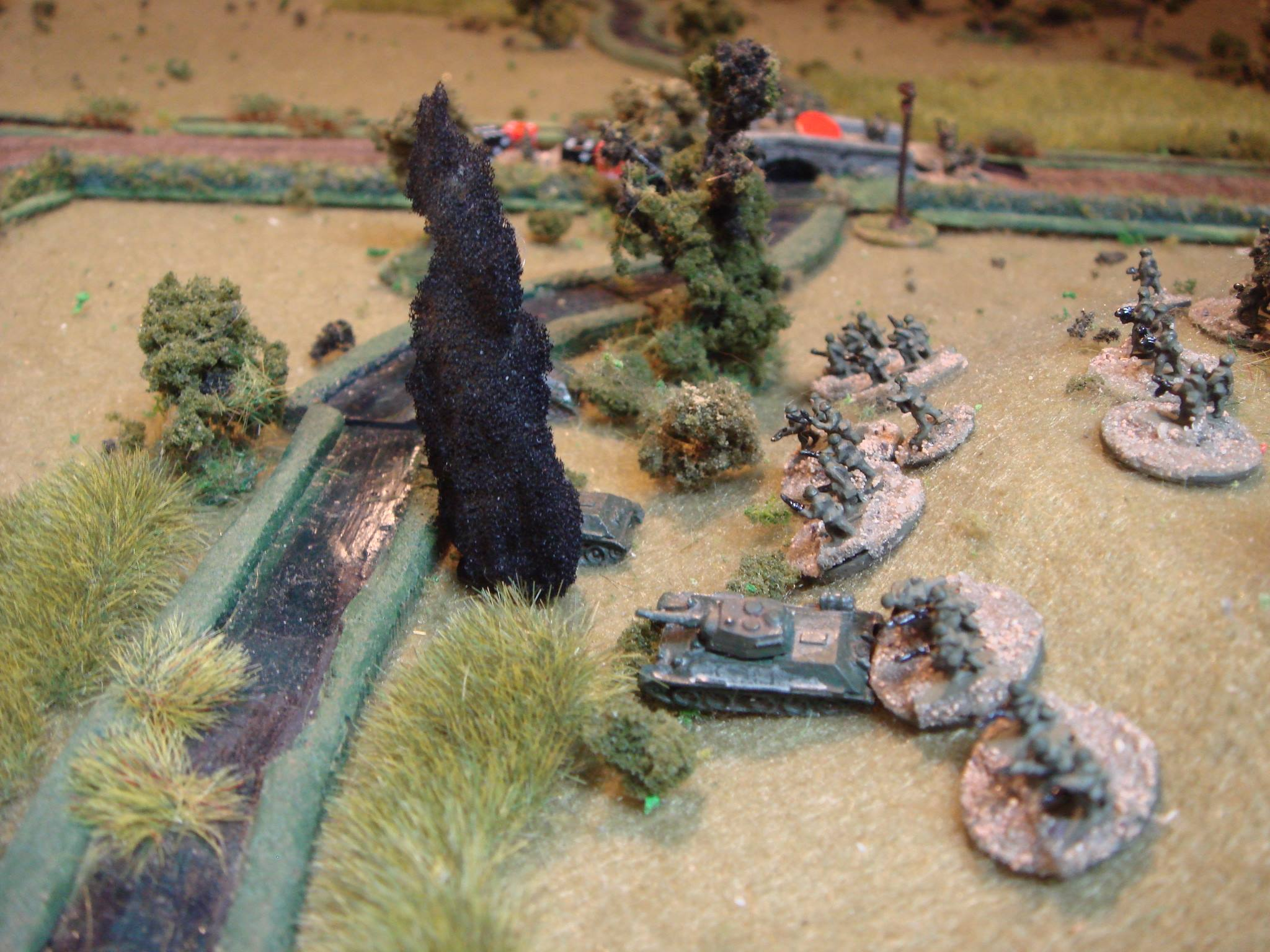 Seeing the platoon shot to bits on the bridge, the Soviet leader orders the remaining two platoons to charge down the hill and cross the stream...a classic human wave supported by the remaining T-34s, one of which is knocked out by the Tiger I.