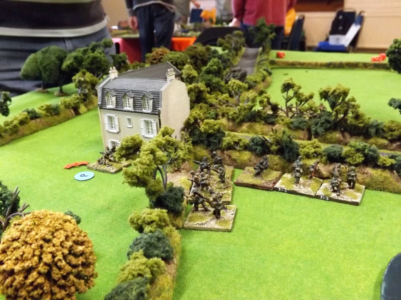 The German defenders are are caught by the rapid flanking move by the British heavy weapons teams