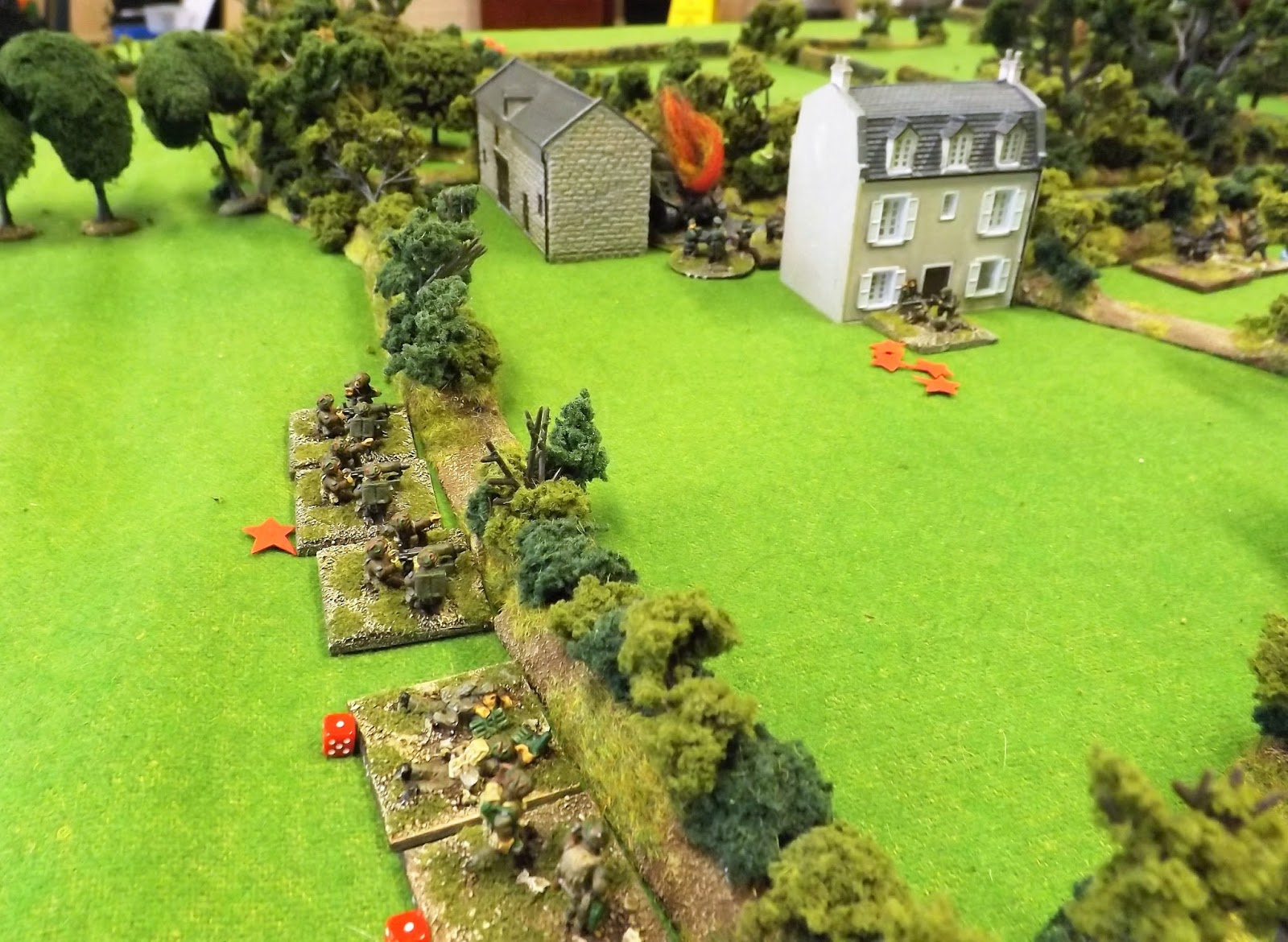 The German return fire when it comes is limited due to the shock and casualties sustained but they manage to inflict a few casualties and knock out a Sherman that burns on the road by the farm