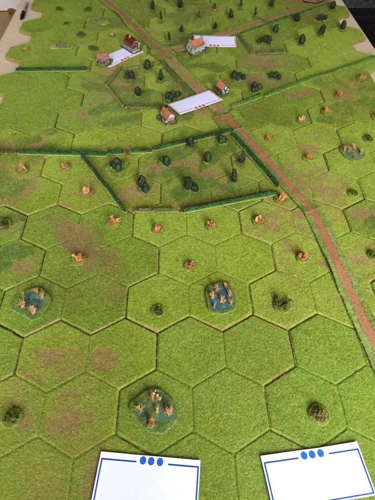 Long shot: British at bottom, Germans in village at top