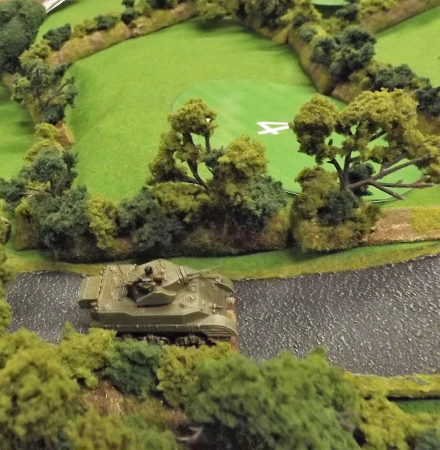 The British tanks are soon spotted advancing cautiously up the hill road