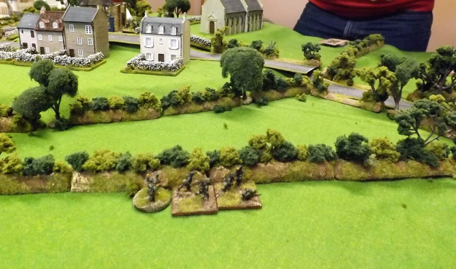 Obst.Fh. Christiansen leads the remains of Zug 2 back along the hedgerows having successfully broken contact