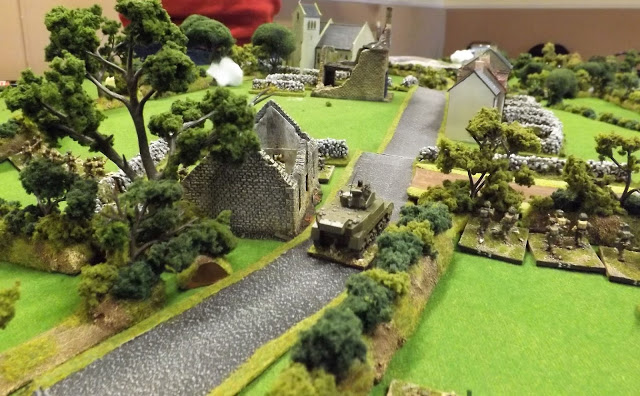 With the forward German positions cleared and the minefield identified as dummy the British line closes in on the village