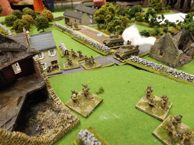 As the British attempt to close on the village under German artillery and MMG fire, the Panzerschreck team open fire on the British tanks