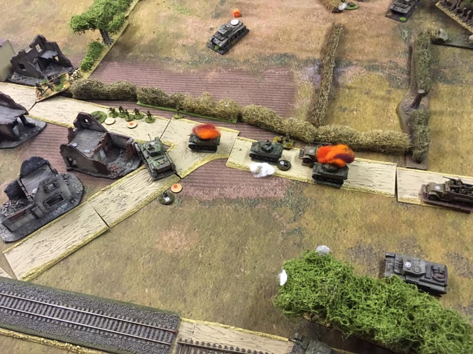 The remains of the reconnaissance platoon are bypassed by the Guards infantry whilst Cromwell tanks home in on their targets