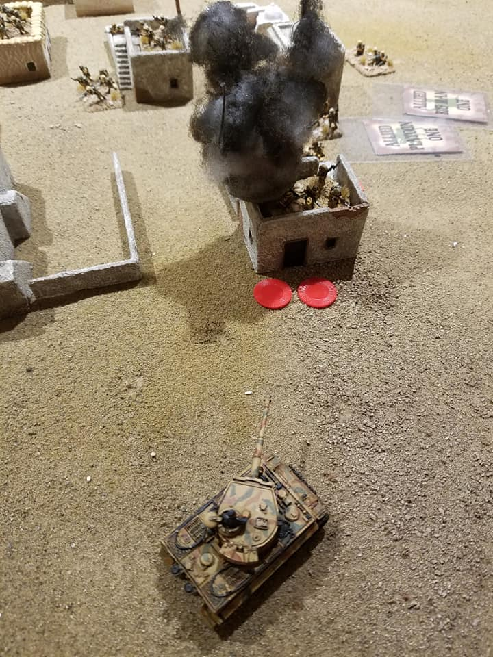 A dice roll of 6 and the building is set aflame by a Tiger of the 501st.
