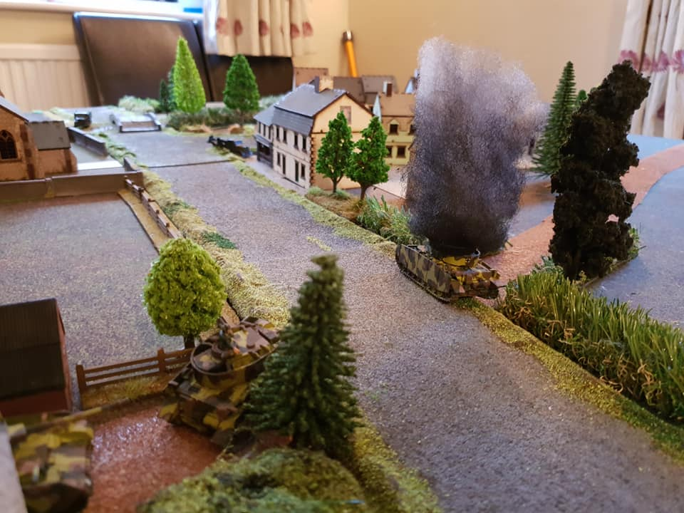MkIV Pz brewed up, hit in the flank by AT gun.