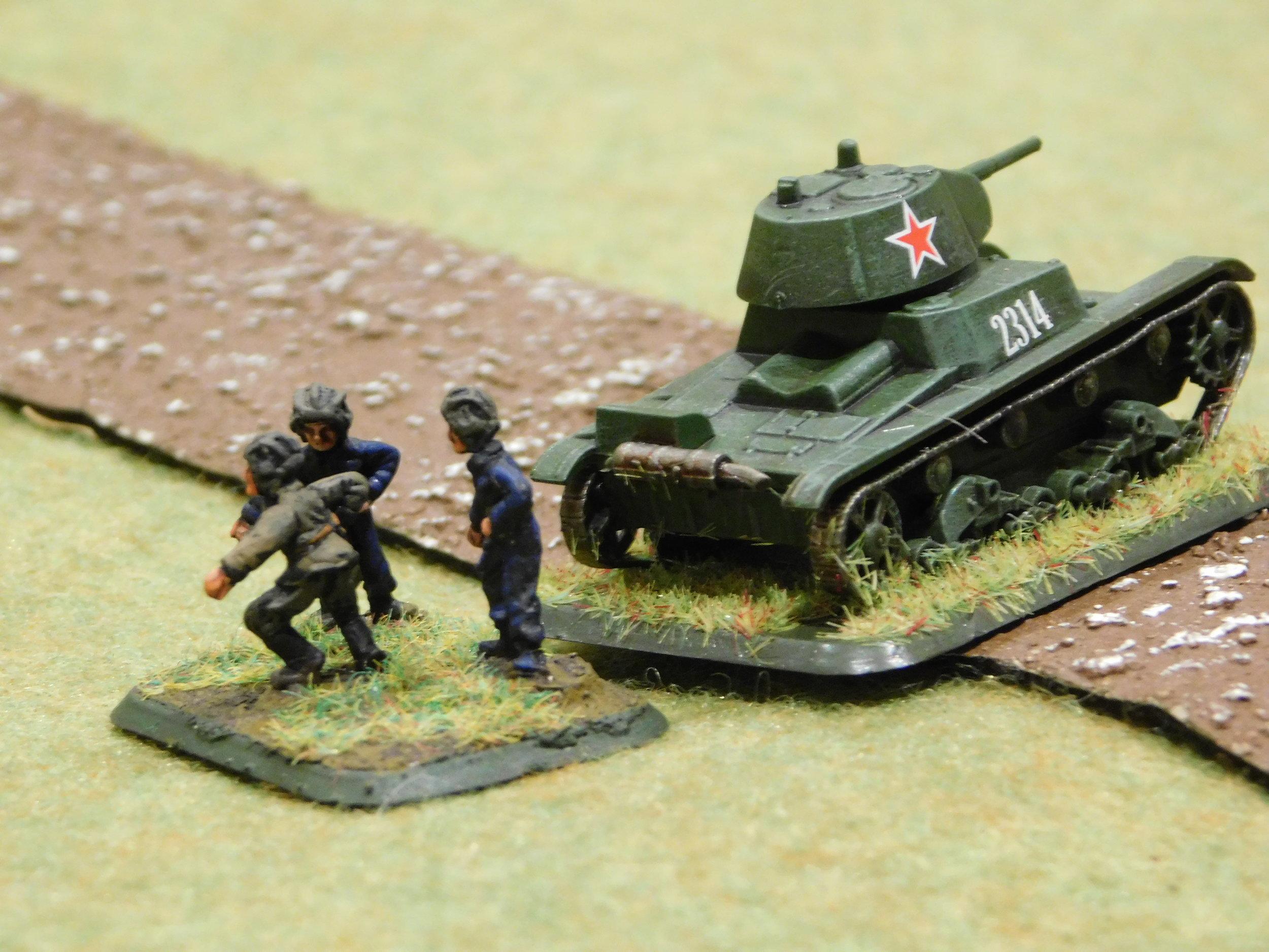 Soviet T-26 crew abandon ship