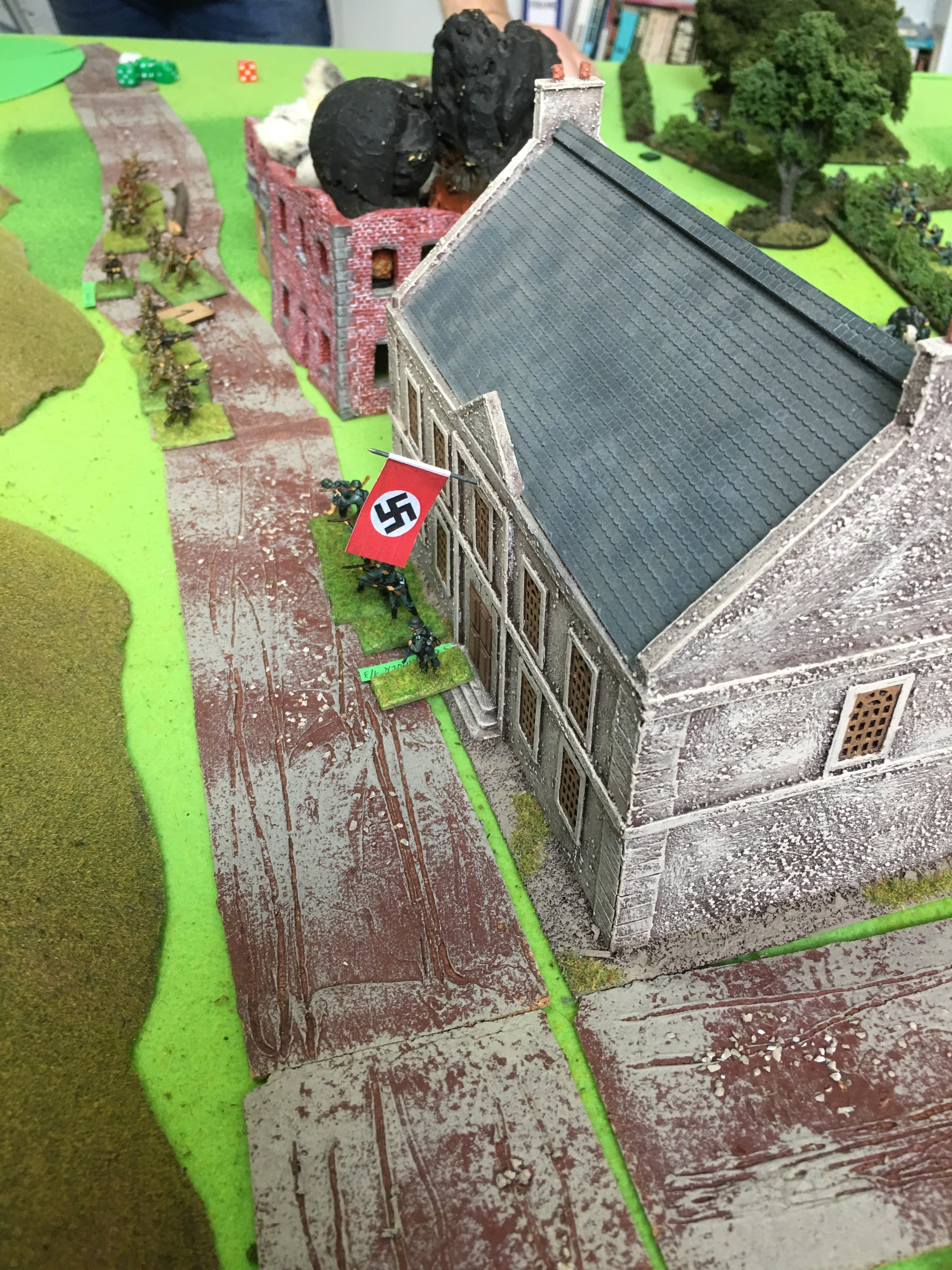 The swastika flies over Seabrook. The ast British defenders try to escape before being surrounded