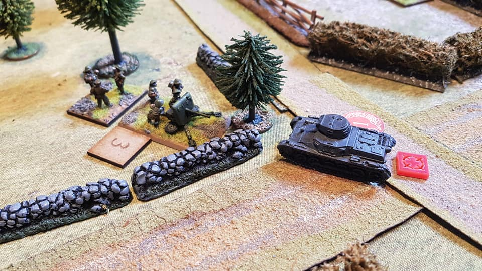 Despite knocking out one tank, the second AFV has its gun damaged but tries to overrun the 2pdr, but is halted by the AT crew just feet from the gun. A last minute reprieve but it blocks the gun's view.