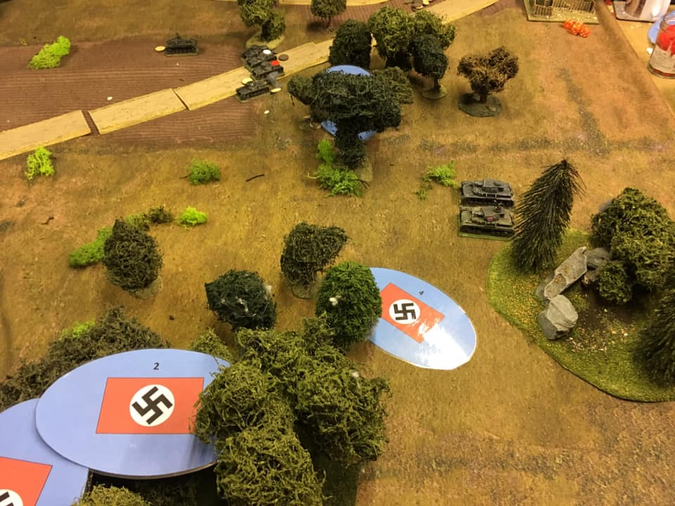 Panzer Is of the HQ Platoon are joined by two Panzer IVA support tanks. Their short 75mm guns idea for lobbing HE at the troublesome AT guns.