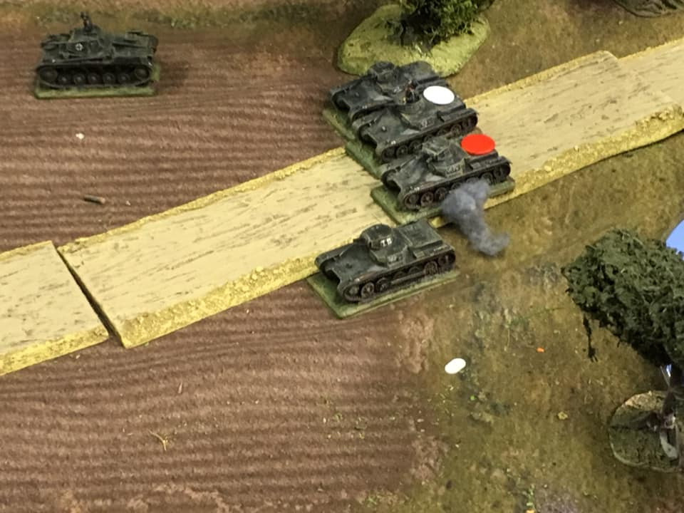 Richard's Panzer HQ Platoon taking hits from the AT guns. Polish poor dice rolls resulted in more shock and minor engine damage than outright kills. The Blitzkreig continued relentless.