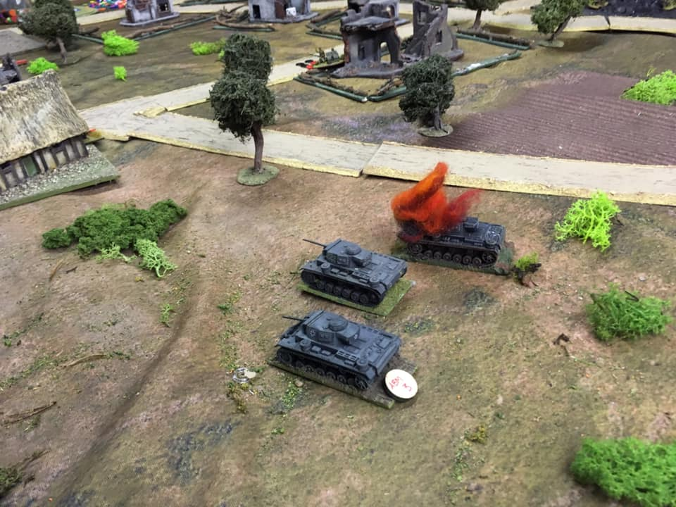 Dale's Panzer III's suffer a brew up: hit in the flank by guess who? Yup the dreaded 37mm guns again.