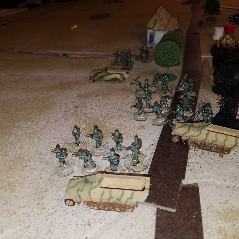 On the German left, a full platoon of Panzer Grenadiers (arriving on the 5th appearance of the Turn Card) force the Americans to call retreat.