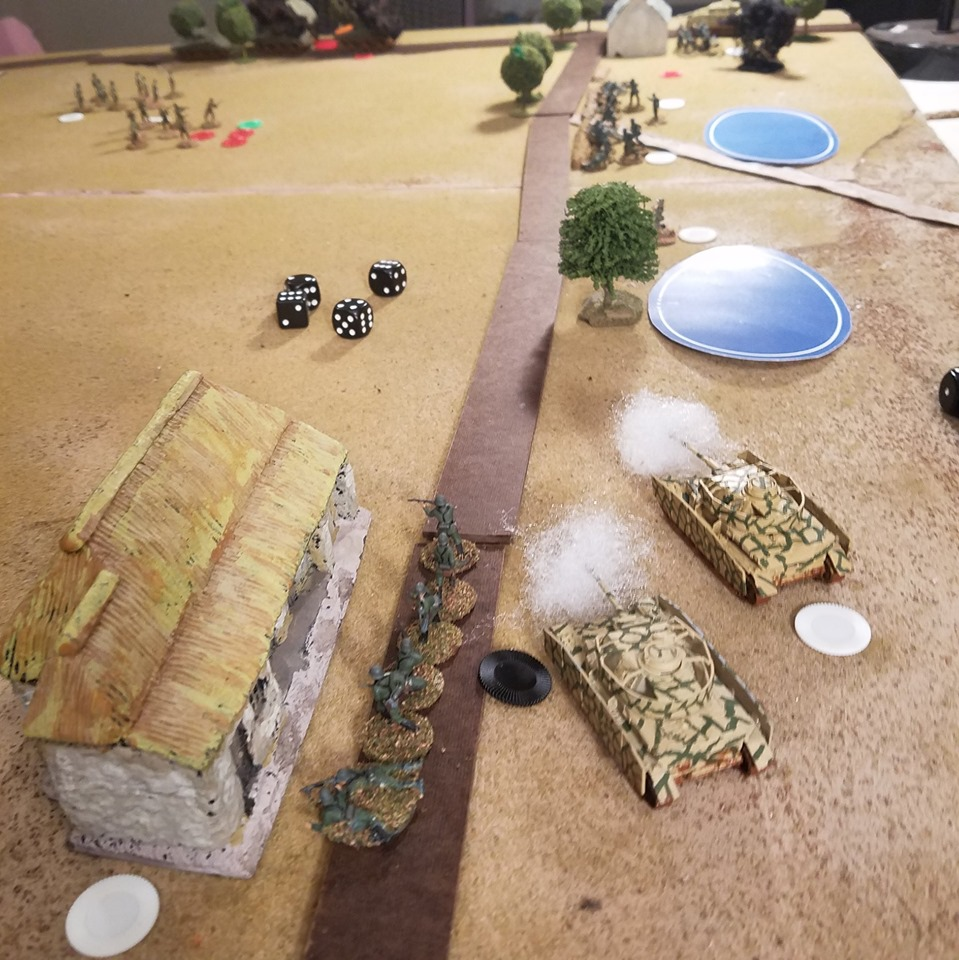 Two Panzer IVs brew up two Shermans in one turn. Great dice rolling by Steve Smith.