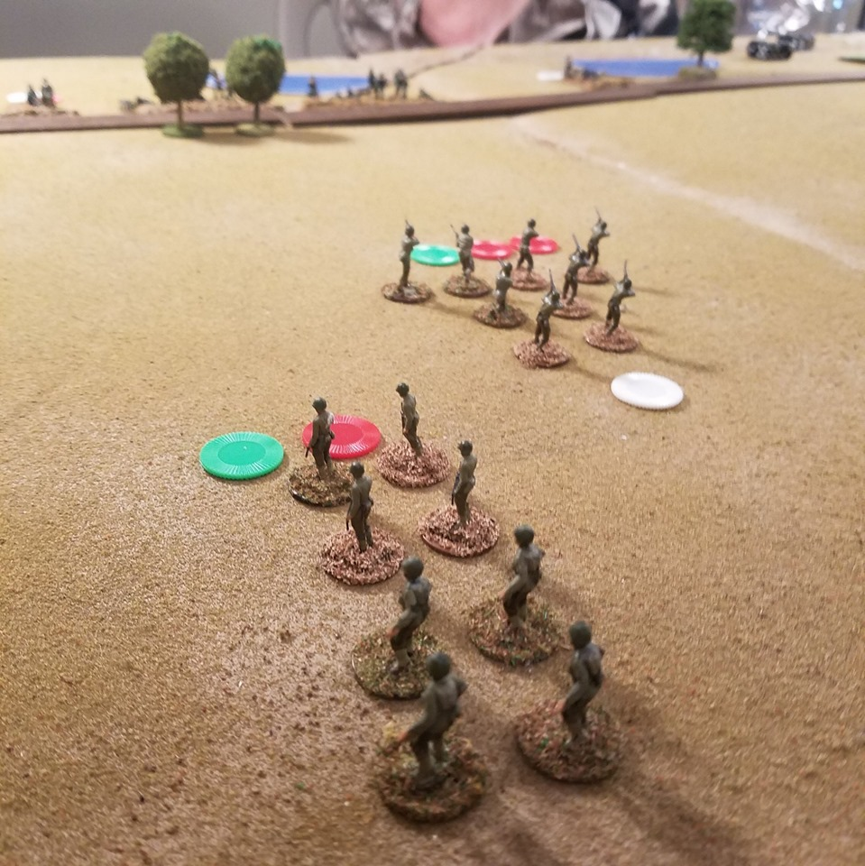 "Red chips on the American squads indicate Shock, Green chips indicating ""taking cover"" and white chips means already activated this turn. Americans lead by Brent Coulthard and Brett McLay."