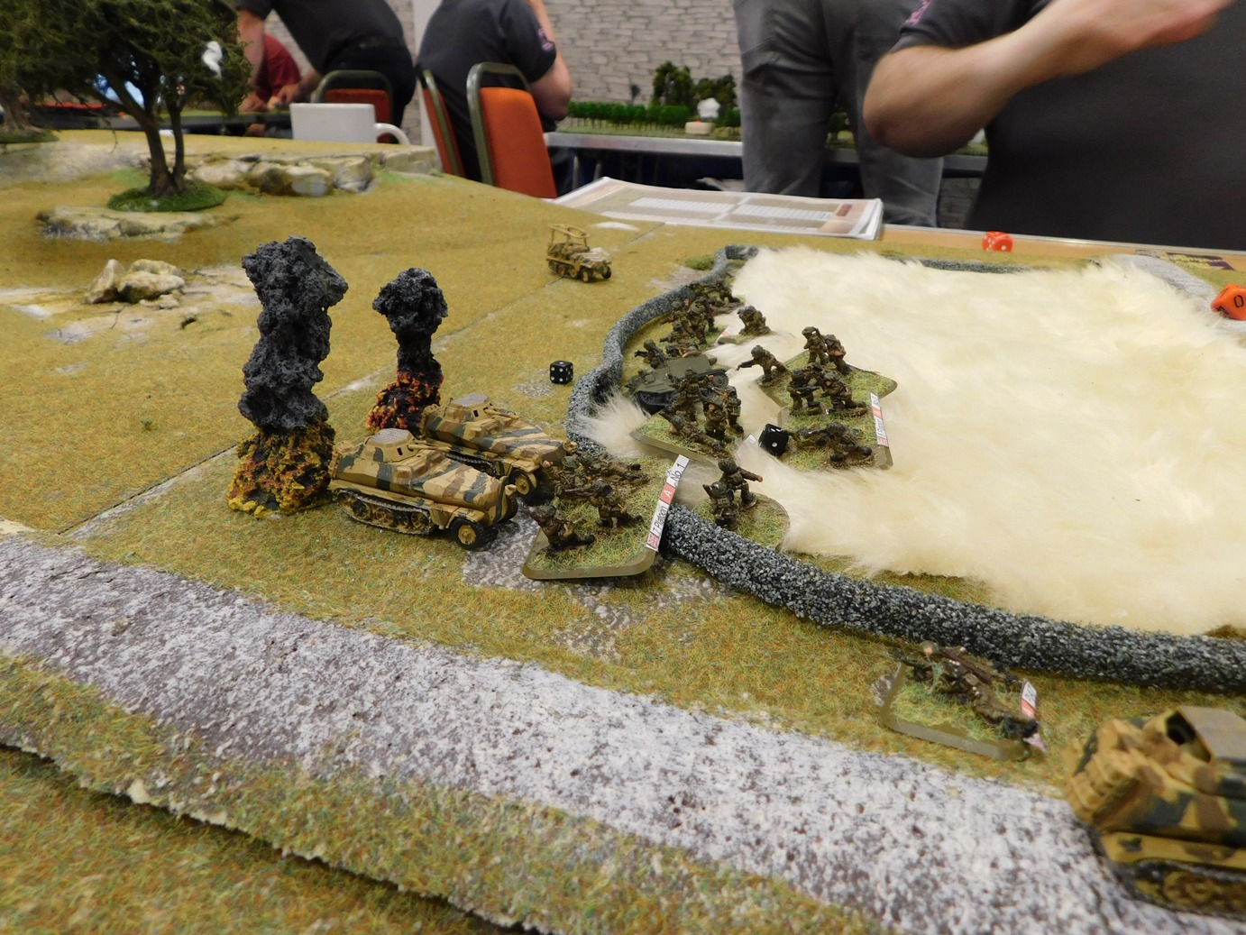 Wall re-taken, two half-tracks down, PIAT team in the right foreground about to turn round and deal with a third