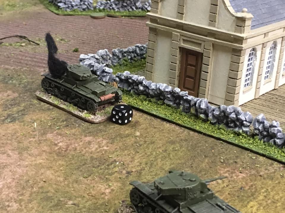A Soviet T-26 takes damage