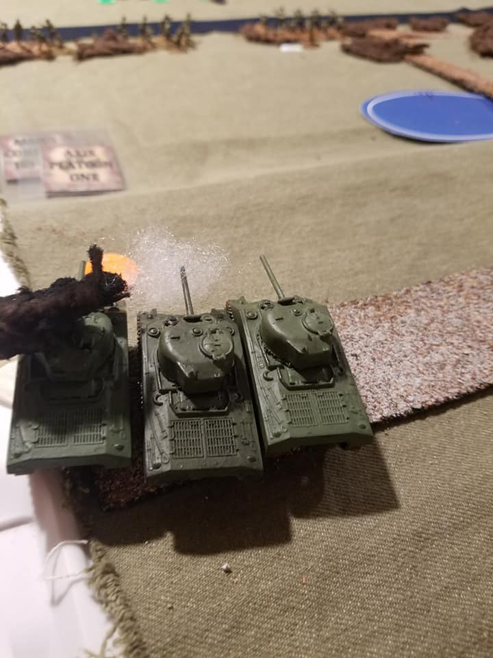 One Sherman was brewed up while the other two had their main guns knocked out